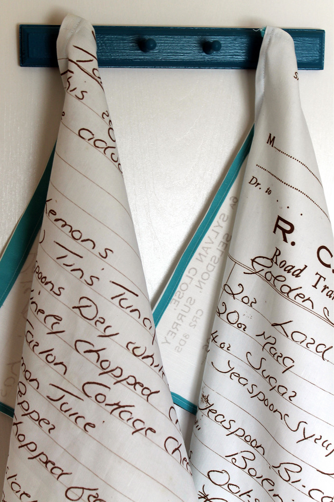 hand written recipe tea towels hanging