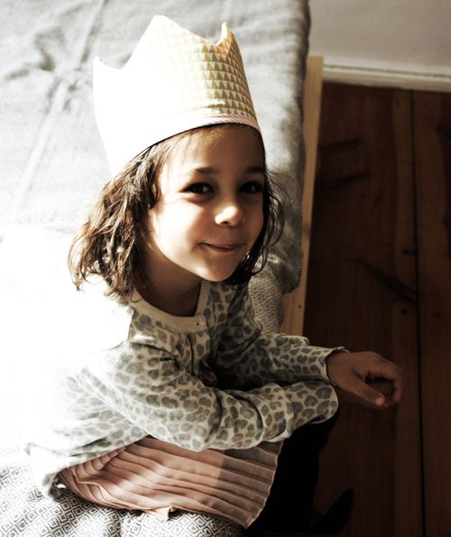 child wearing a DIY fabric play crown