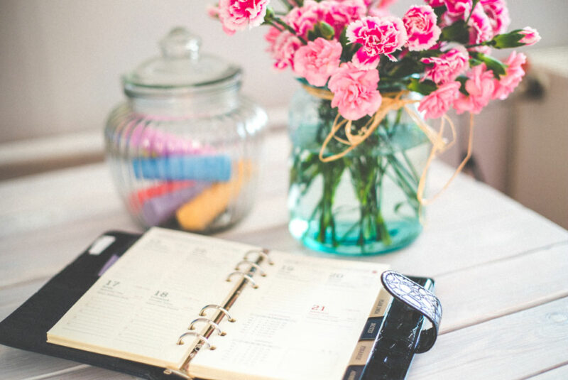 flowers on desk with open calendar