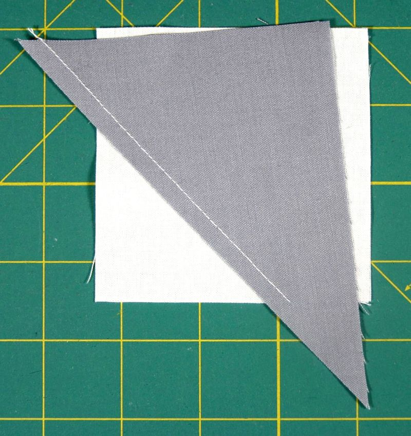 Sew along the edge of the triangle.