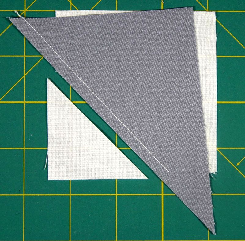 Trim the excess of the white square