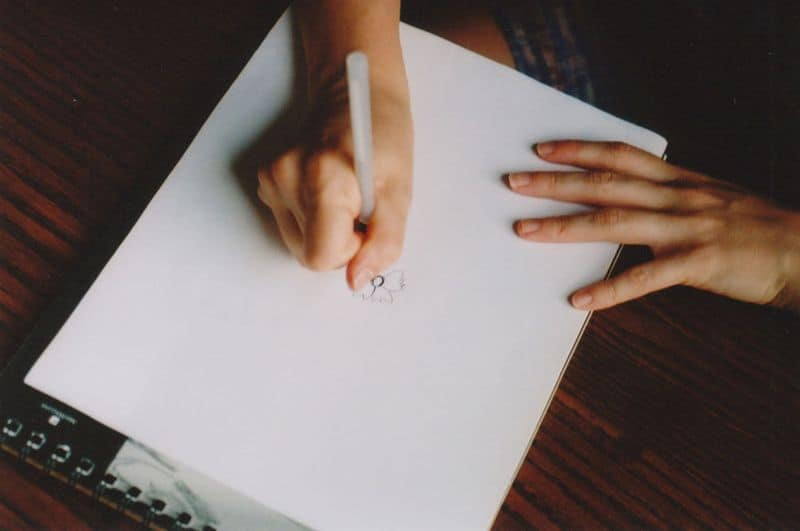 1drawing_hands_from_above