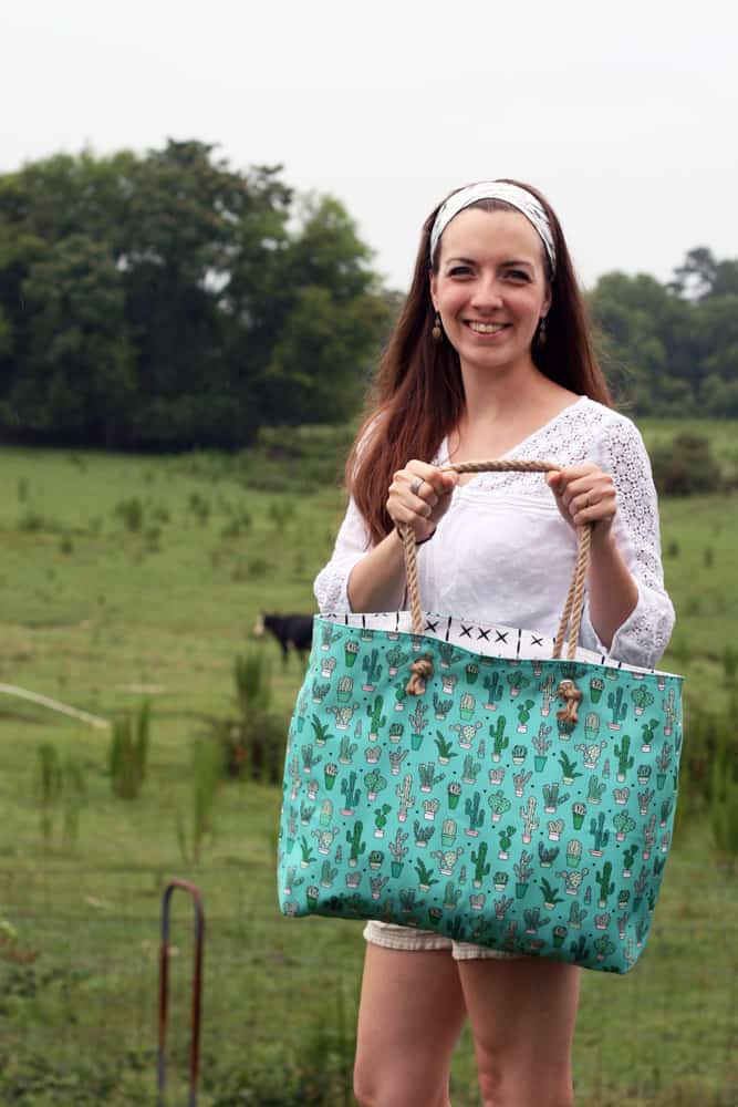 Sara of Radiant Home Studio carrying her beach tote