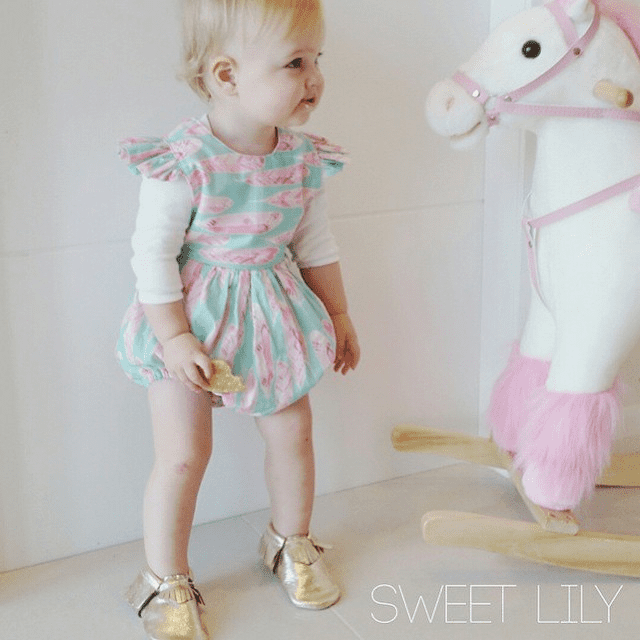 @sweetlilyboutique stitched up this adorable romper for her handmade shop!