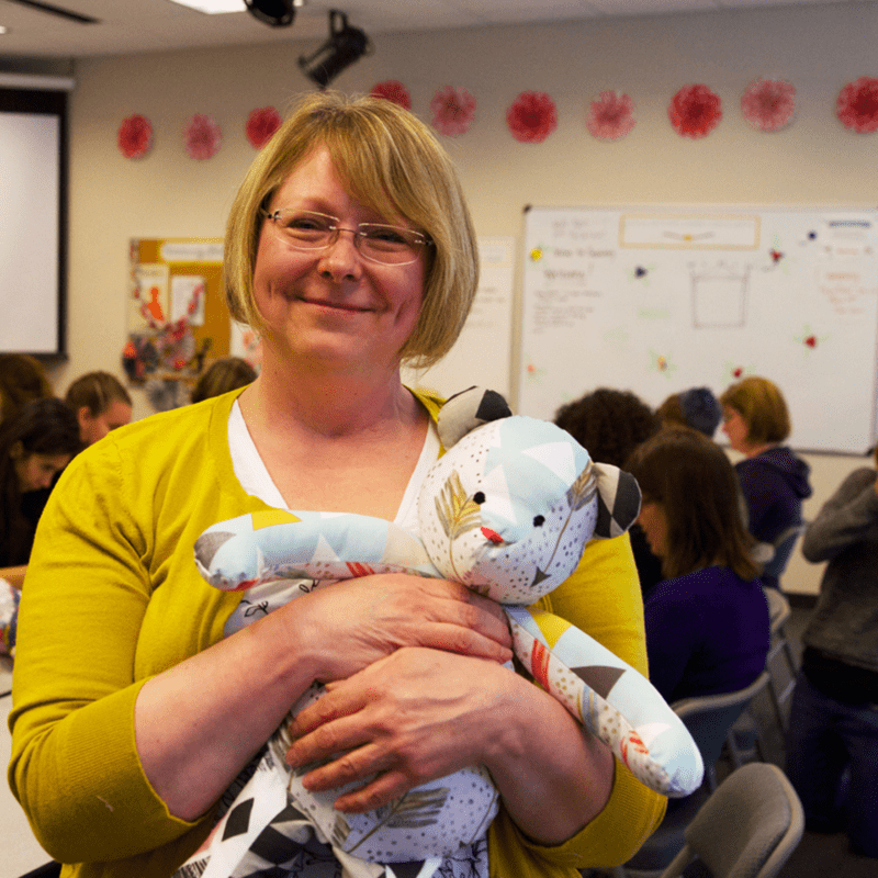 Spoonflower community member Ann gives her bear one last hug before donating it to RARE Science.