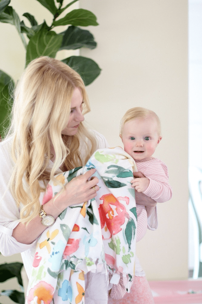 Natalie Malan swaddles her baby in soft, cozy Fleece. Learn how to sew up a cozy no sew blanket with Fleece!