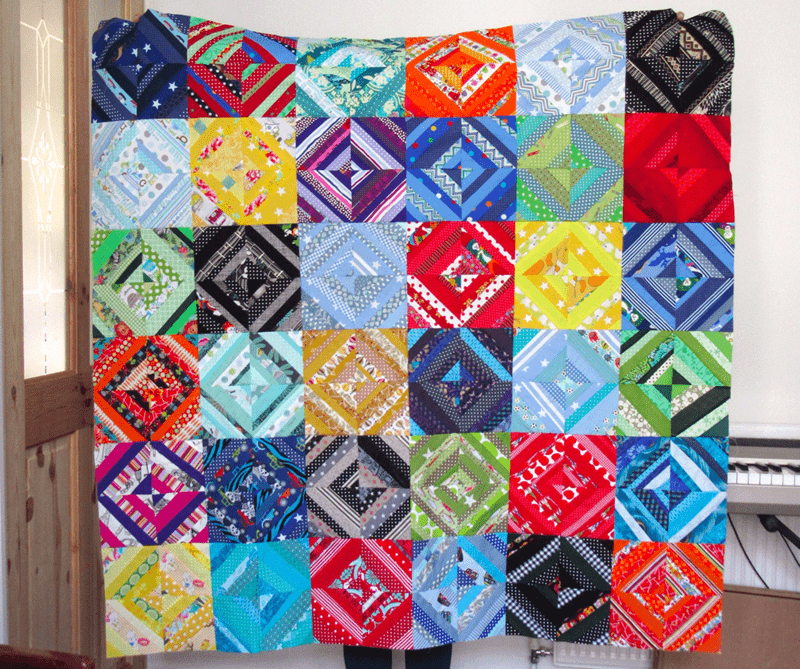 A finished quilt is ready to be donated to a child at Siblings Together