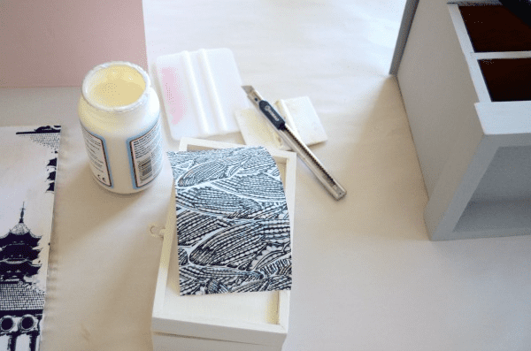 carefully trim each paper piece and mod podge to your box