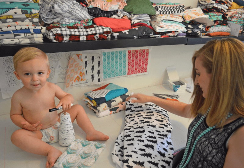 Rachel Roberts in her creative space with son Theo