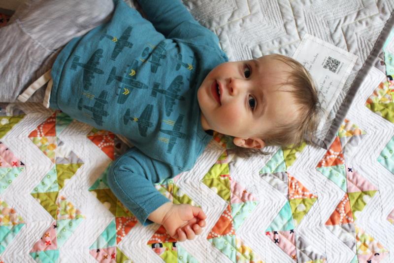 child on quilt