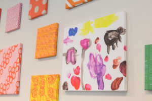 Kid's canvas art on a gallery wall