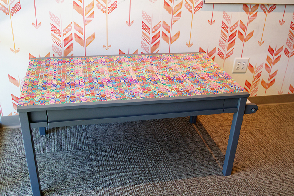 Finished art desk, covered in woven peel & stick wallpaper