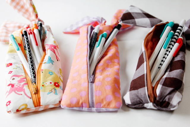 Three zippered patterned pencil pouches