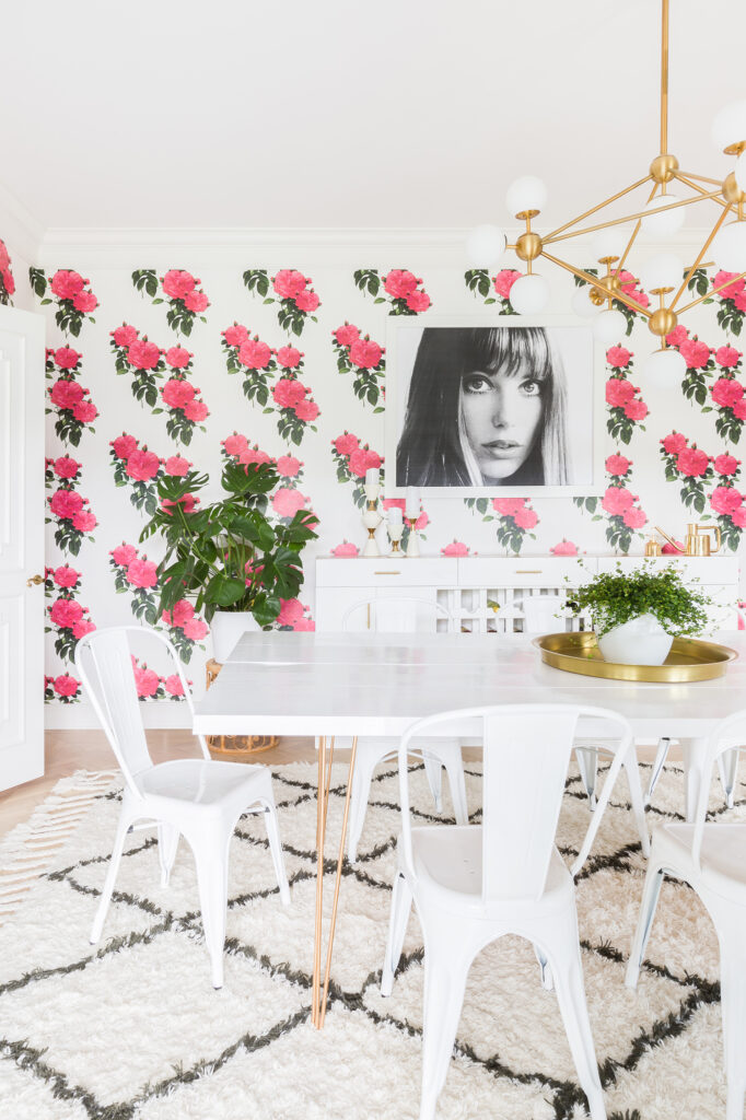 Elsie of A Beautiful Mess's dining room refresh featuring Rodarte Rose wallpaper by Peacoquette. Available on Spoonflower