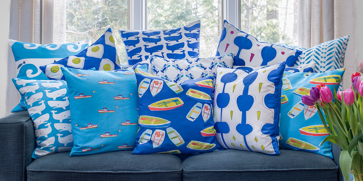 Layers of colorful throw pillows on a couch