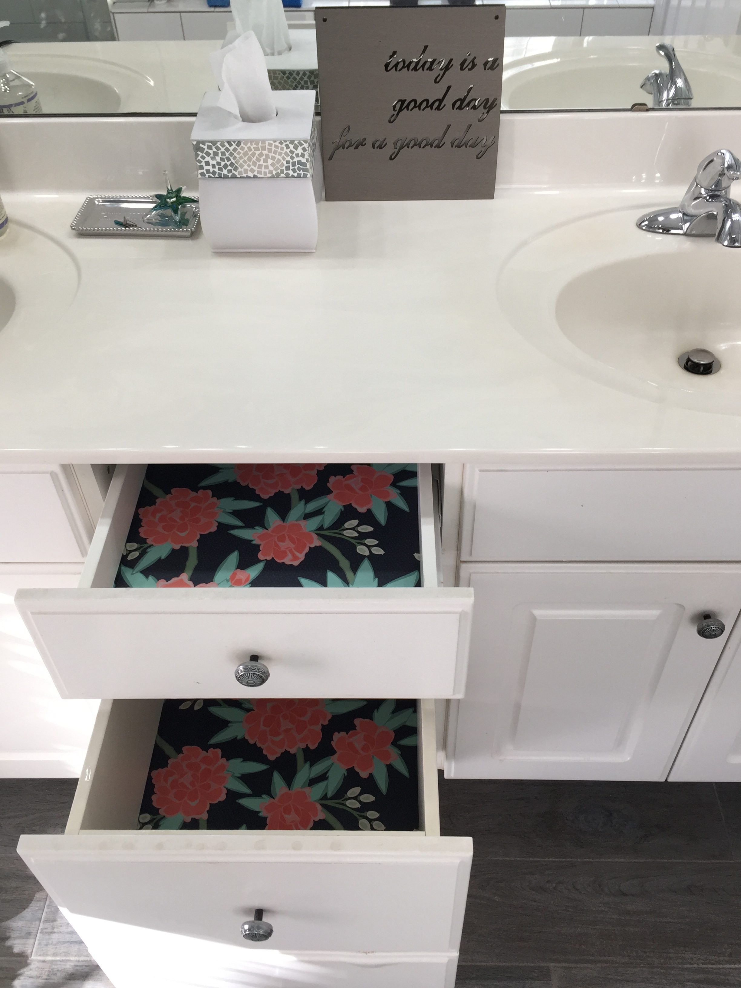 Two bathroom drawers with Spoonflower peony wallpaper