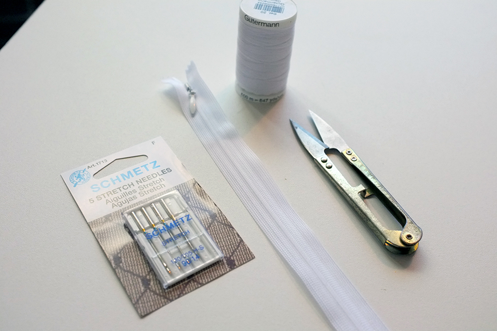 sewing notions: thread, needles, zipper and thread snips