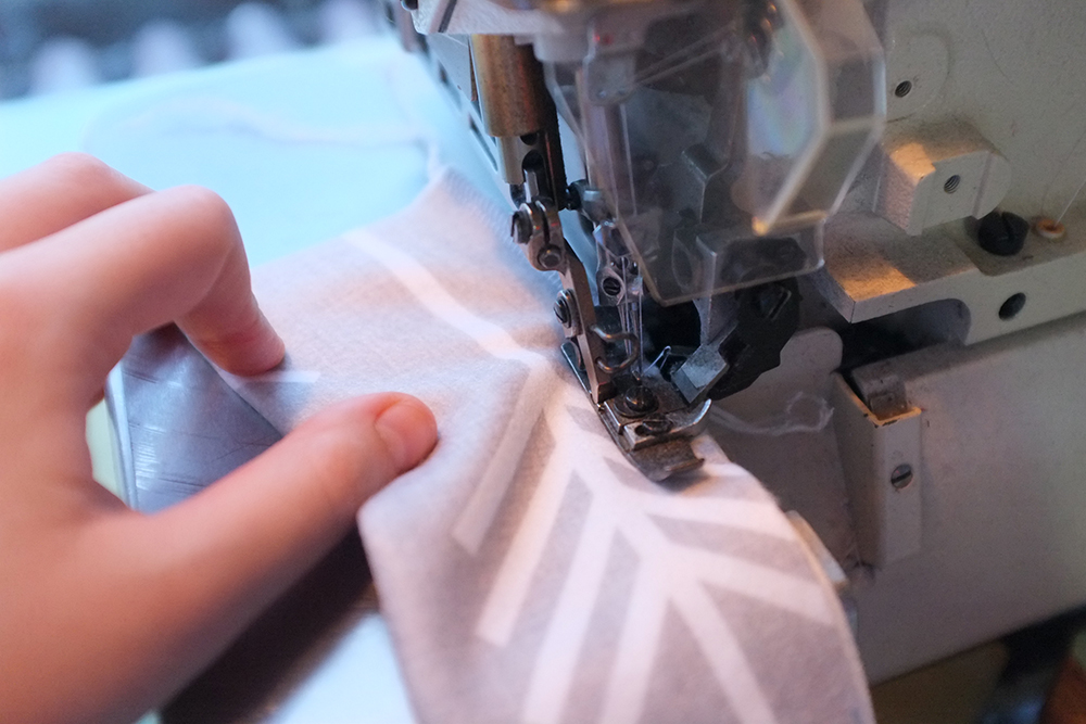 strip of gray fabric being sewn