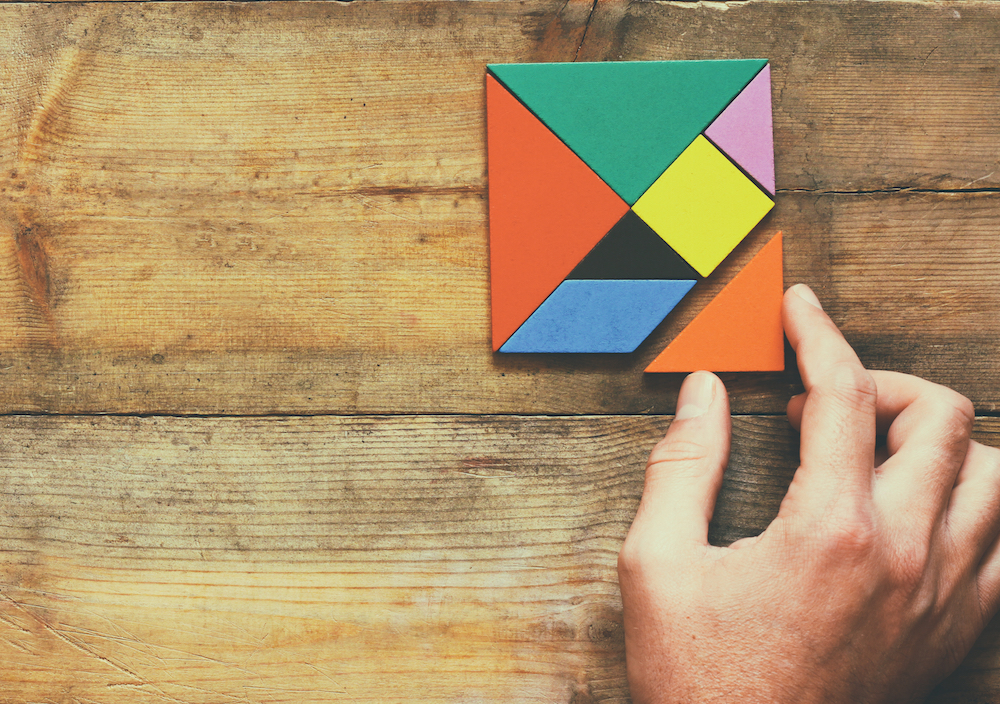 tangram puzzle with hand
