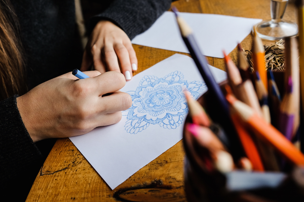 woman drawing mandalas