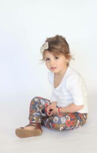 Young girl wearing Buddha Babe leggings