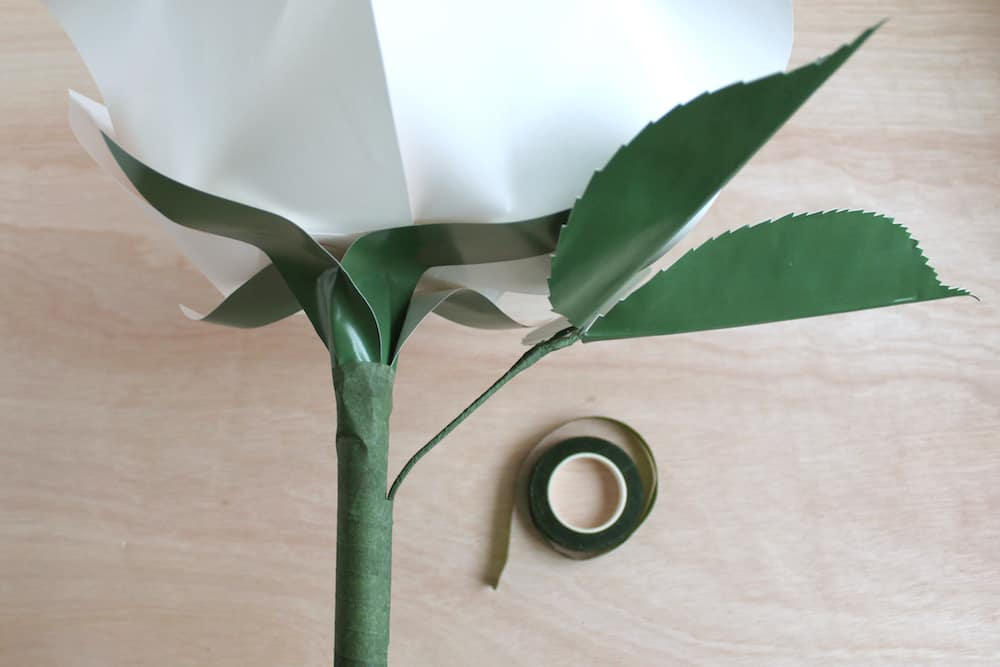 paper flower DIY rose instructions: add floral tape to dowel to finish