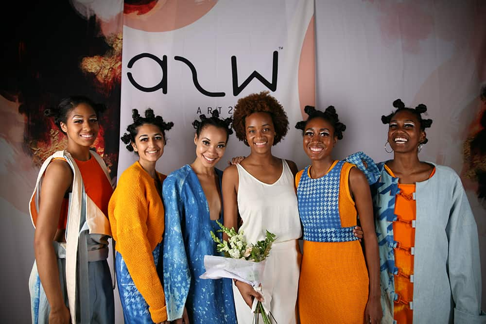 Designer Cristina Wright enjoys a moment with her models after the show.