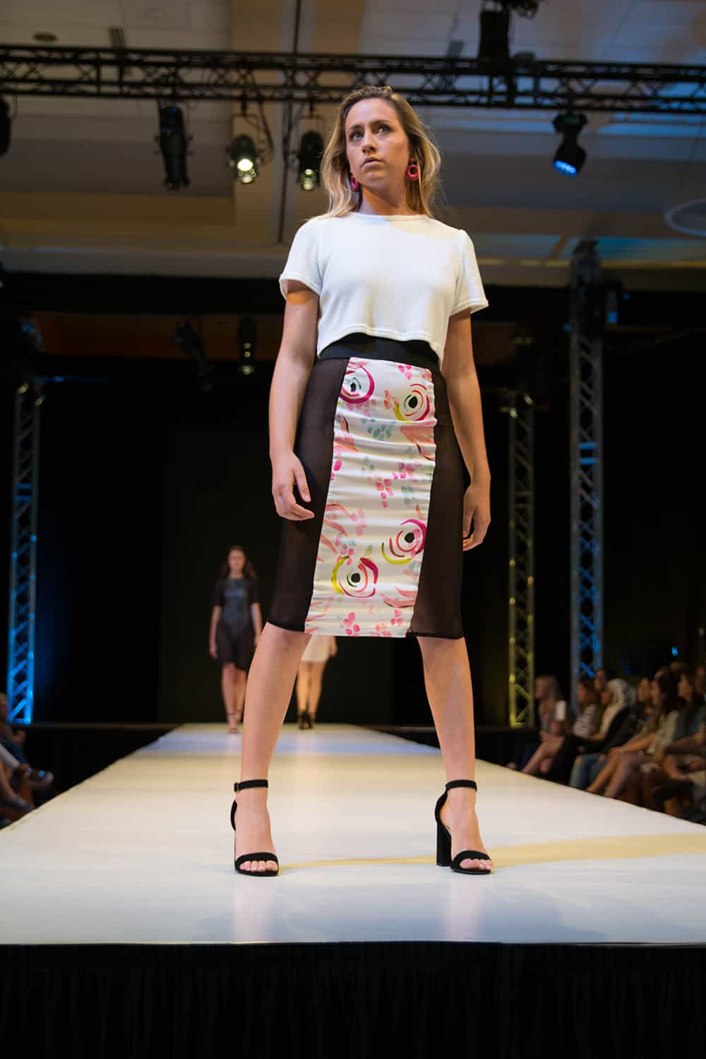 "A model from the collection ""Floral Street"" by Grace Hallman walks the runway"