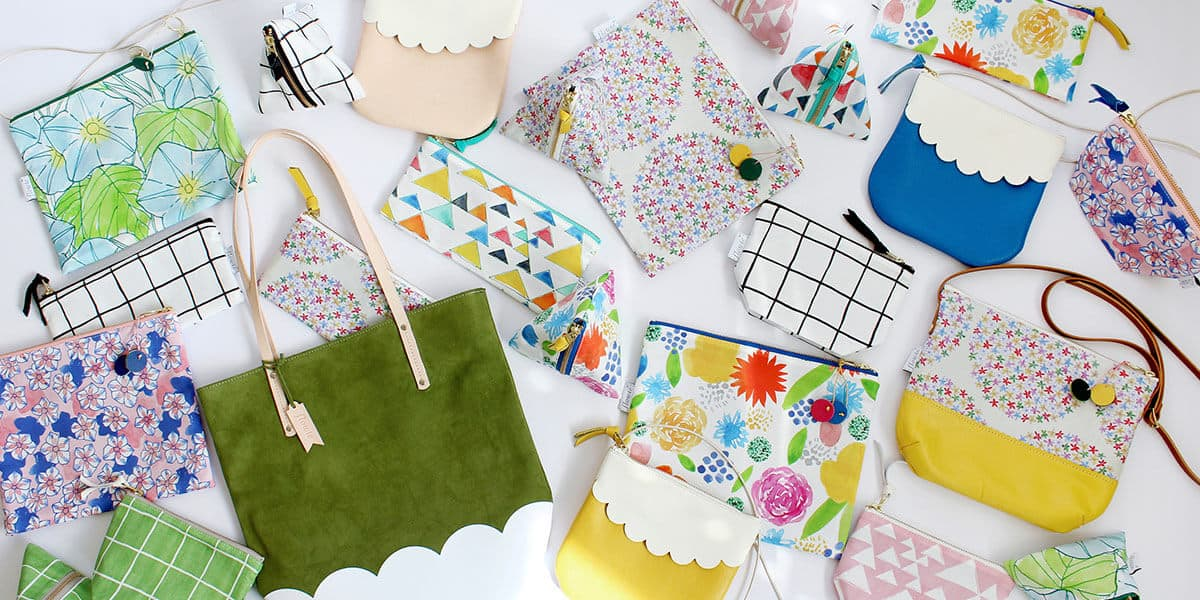 An array of brightly colored pouches and bags from Flowie