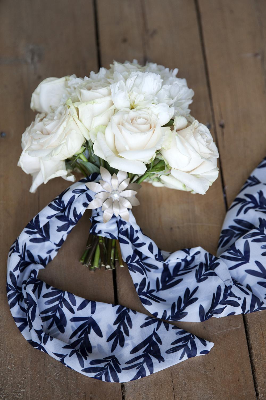Floral bouquet with Lumen chiffon wrap