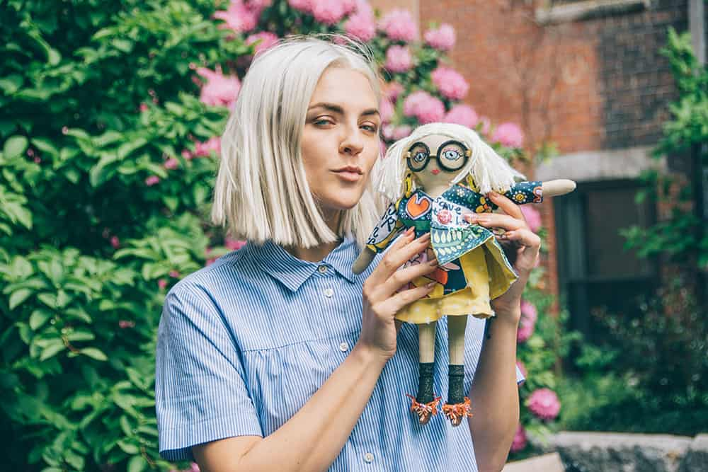 Erin Robertson poses with a mini version of herself with leftover scrap fabric