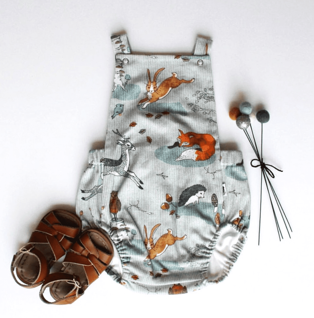 A baby romper made from a nouveau_bohemian design