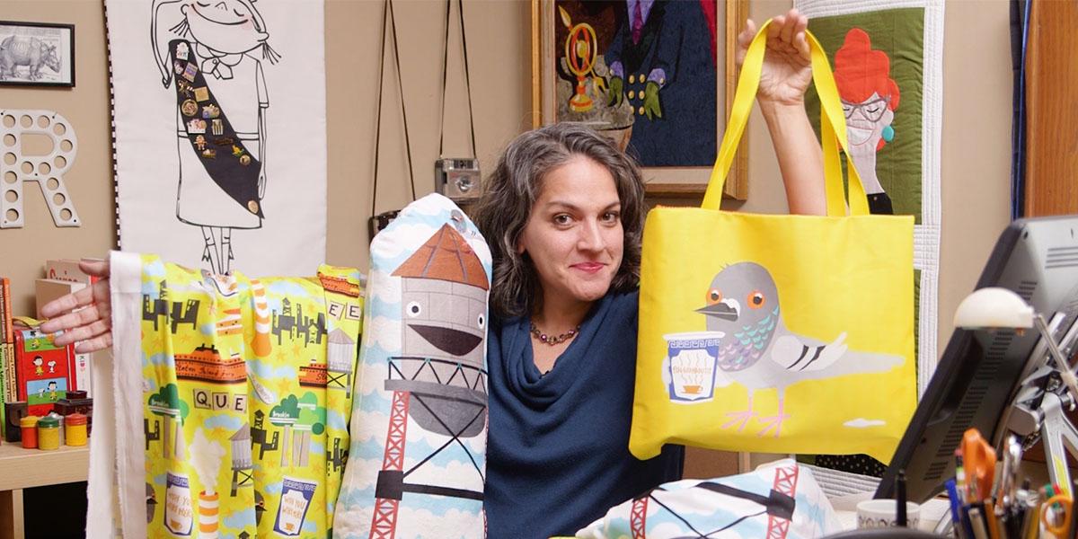 Samarra Khaja aka SammyK holding her designed pieces | Spoonflower Blog