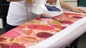 Start by ironing your fabric flat