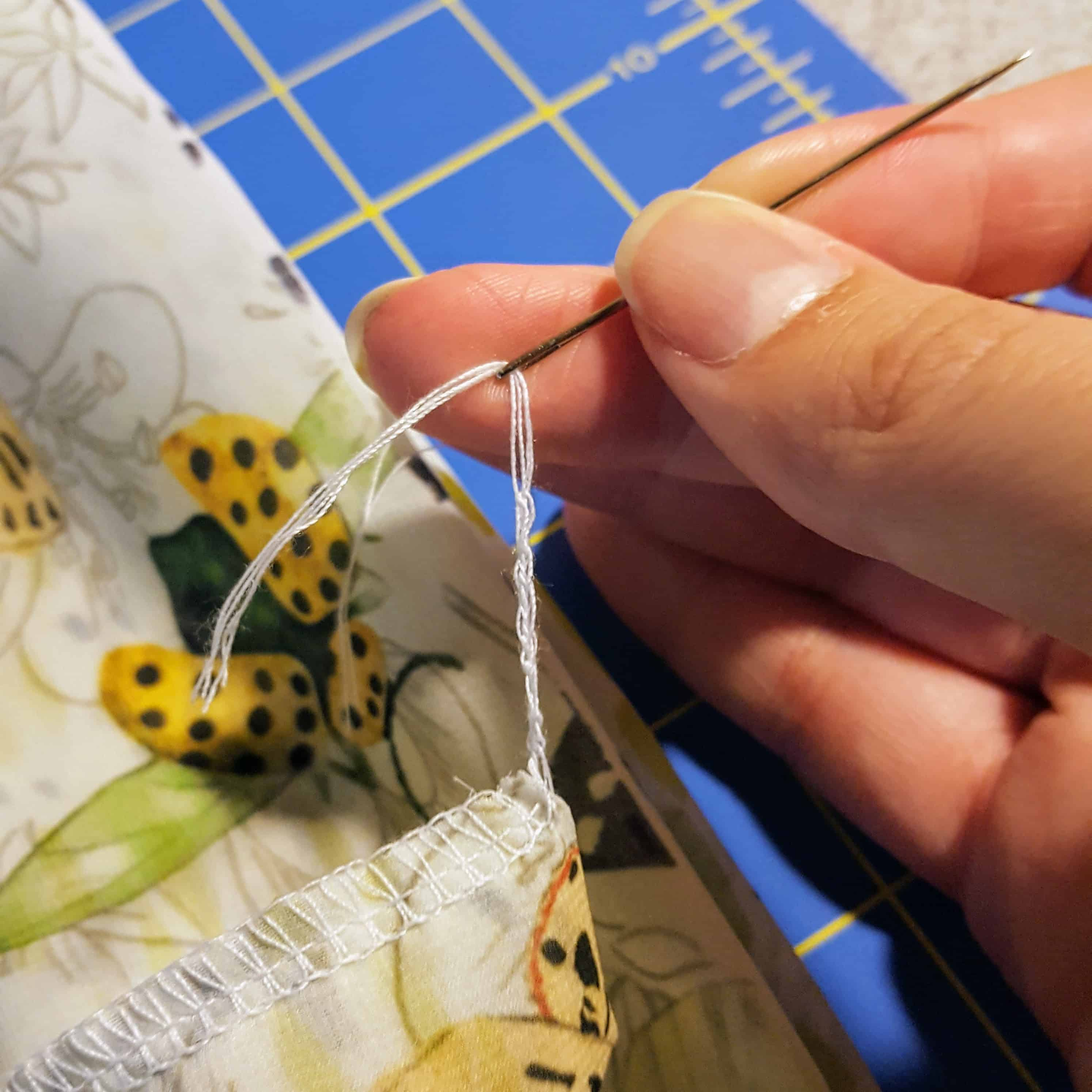 Threaded the loose thread through a tapestry needle | Spoonflower Blog