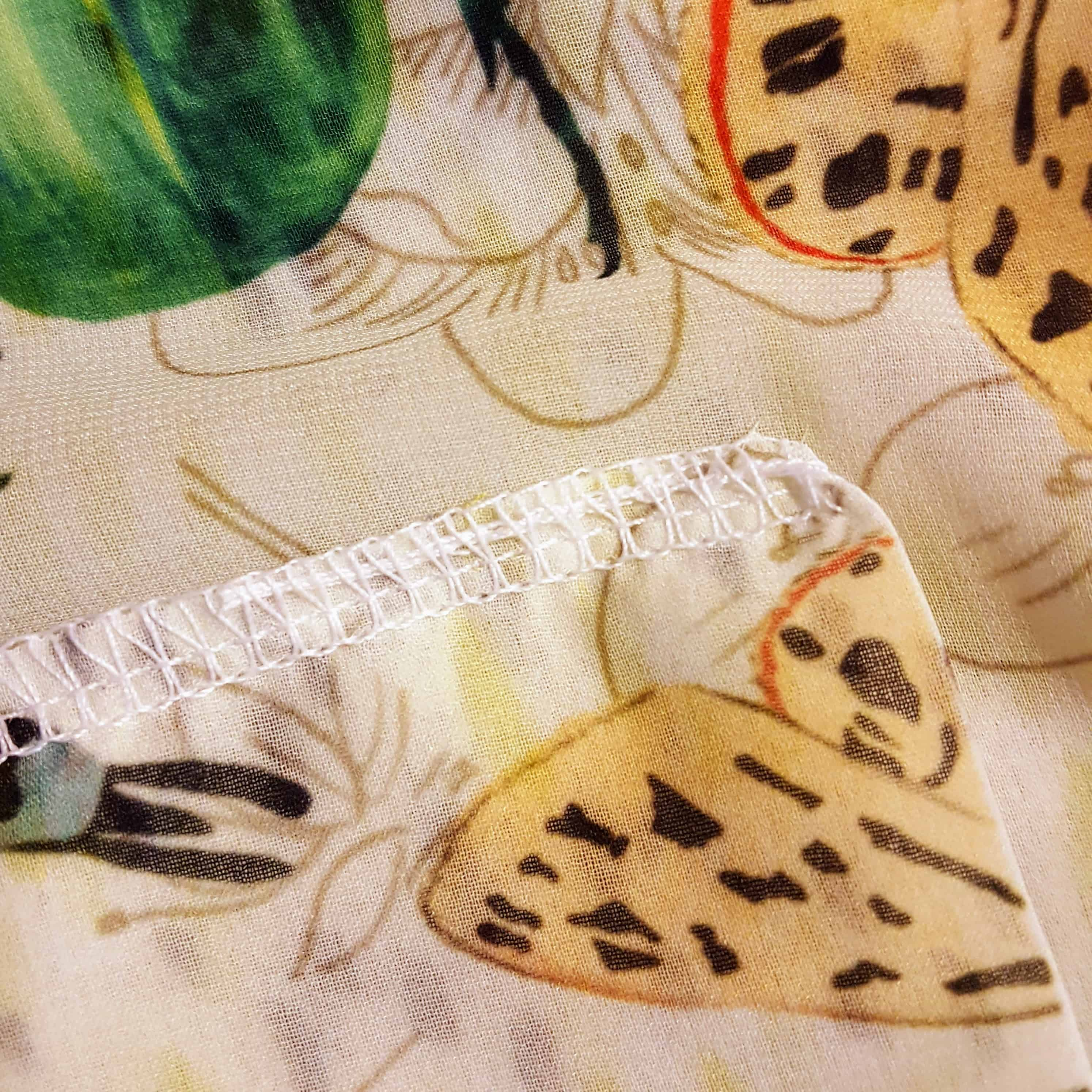 The tail made from thread is now held securely and discretely within the serged seam! | Spoonflower Blog