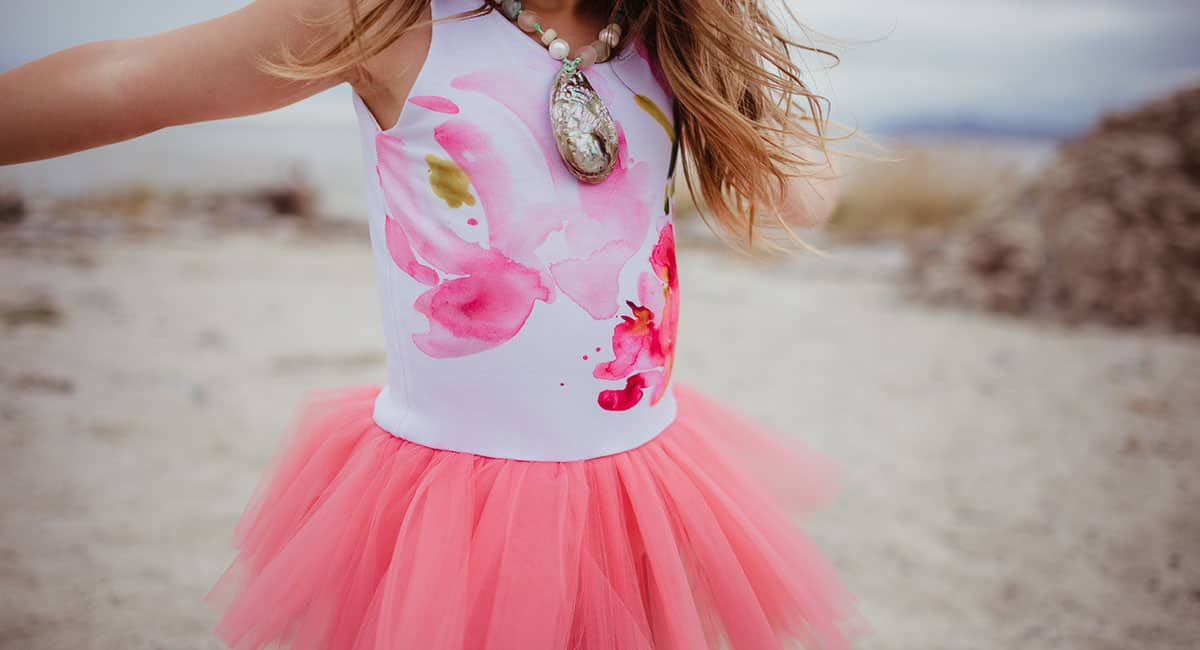 Girl wearing watercolor art top and pink tulle skirt   Meet the Maker: Annie Casale   Spoonflower Blog