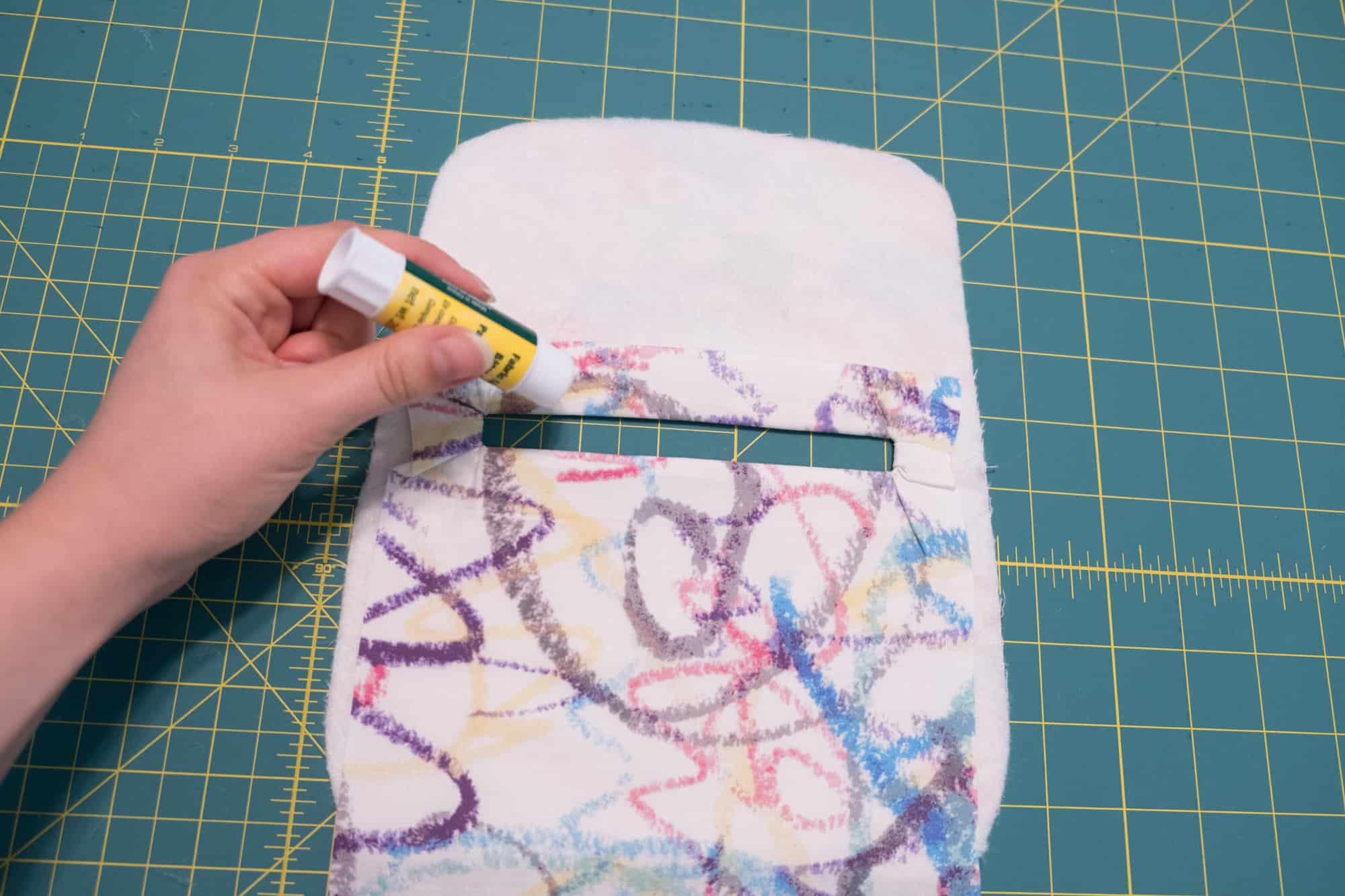 Place a strip of glue or wash away tape around the backside of the zipper hole | Spoonflower Blog