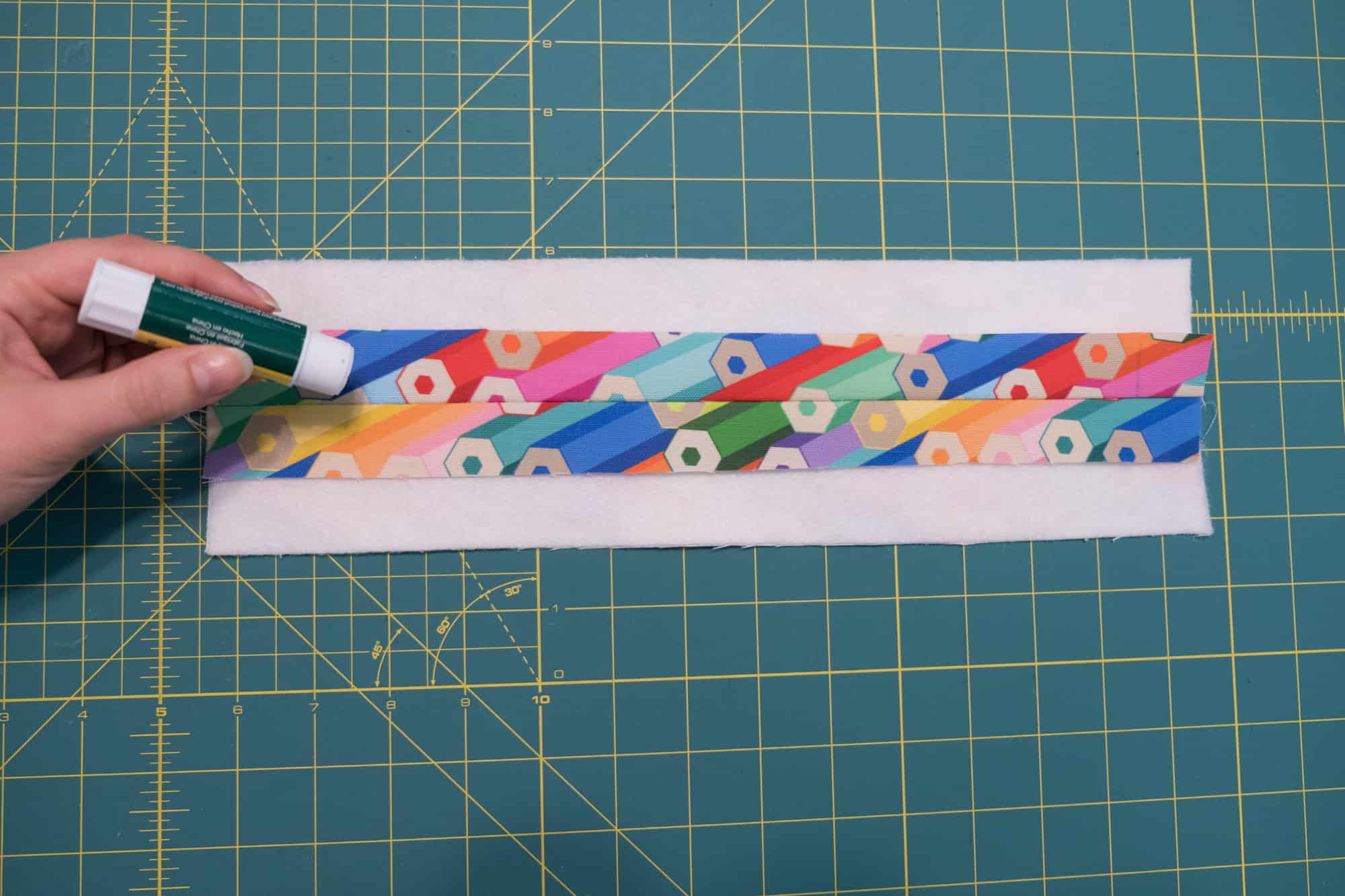 On the wrong side of the panel, run a strip of glue or tape along the seam | Spoonflower Blog