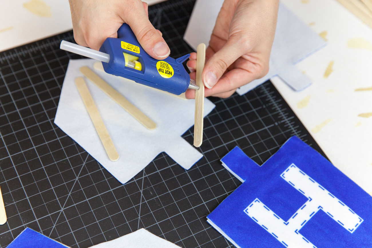 Applying Hot Glue to the first side of the dreidel pieces | Spoonflower Blog
