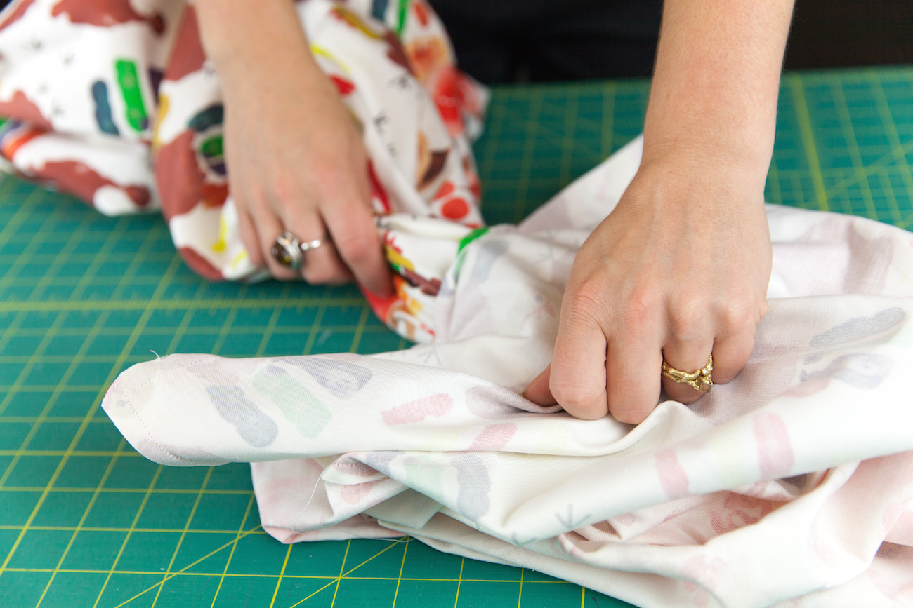 Pulling fabric through the unsewn opening | Spoonflower Blog