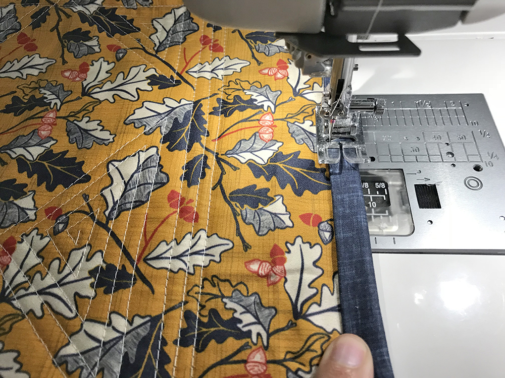 Fold the binding in half and stitch in place | Spoonflower Blog