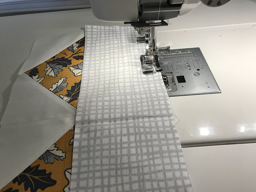 Stitch the top fabric strip to your quilt block panels | Spoonflower Blog