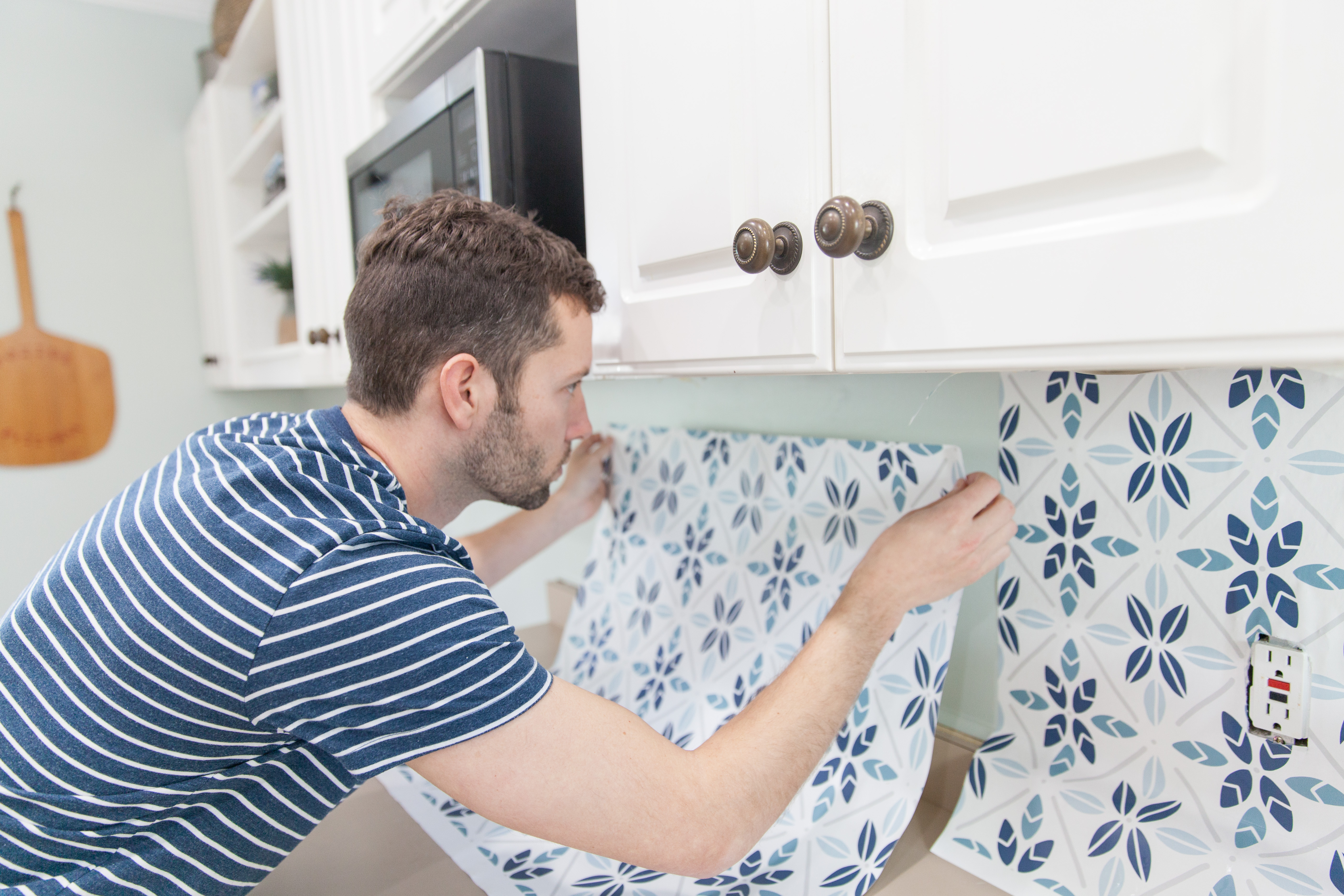 Hanging the wallpaper | DIY Wallpaper Backsplash | Spoonflower Blog