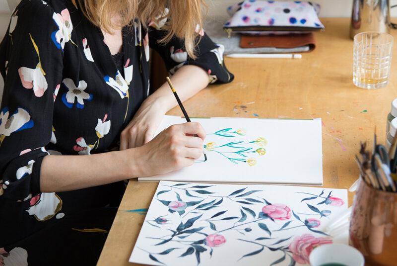 Spoonflower designer youdesignme painting at her desk