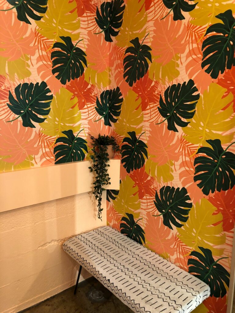 Alison's design Fall Tropical Leaves takes center stage in the Blackbird Fabrics restroom. | Spoonflower Blog
