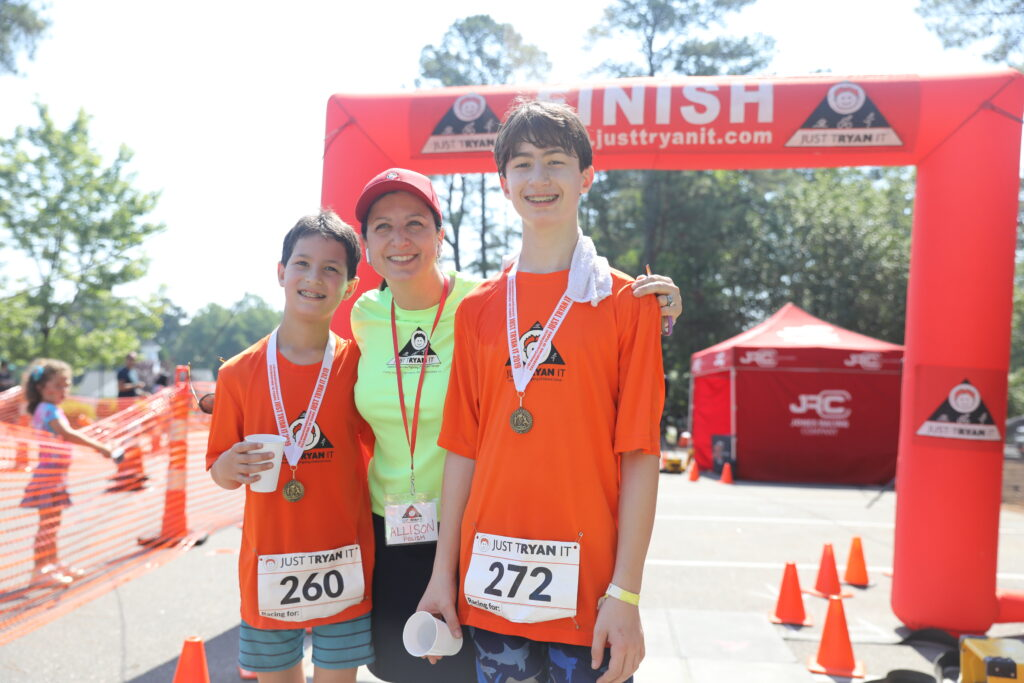 Allison and two of her sons celebrate another JTI triathlon! | Spoonflower Blog