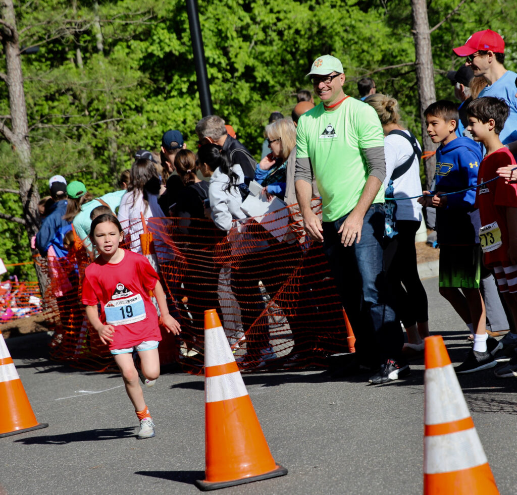 Spoonflower CEO Gart Davis cheers on runners as they sprint to the finish line. | Spoonflower Blog