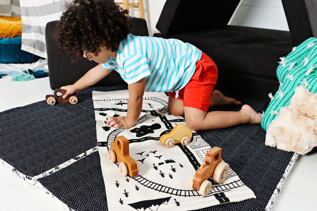 Toddler playing cars on a fabric playmat | Spoonflower Blog