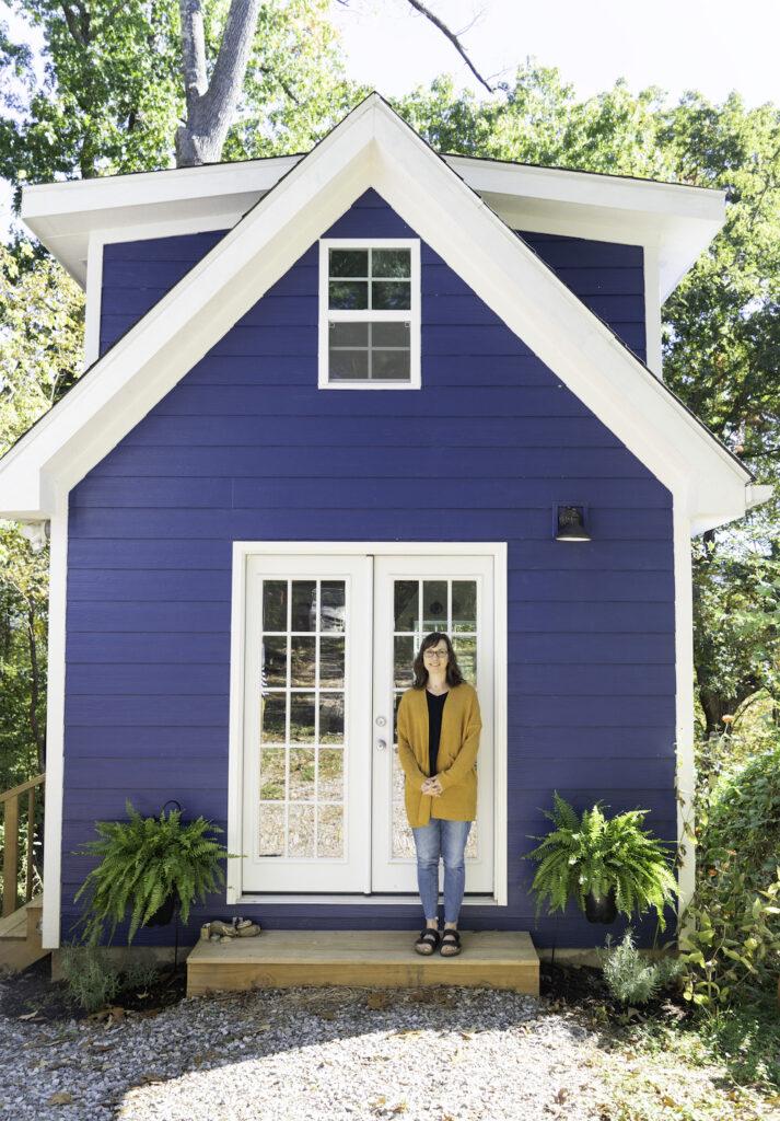 Liz outside her Asheville-based cozy, blue studio | Spoonflower Blog